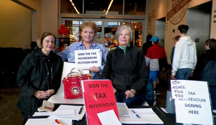 Mary Miller, Colleen Basam Taylor and Carolyn Wavrin stand in Harmon's to collect signatures for a petition against tax reform. (Photo by Hailey Danielson | The Daily Utah Chronicle)