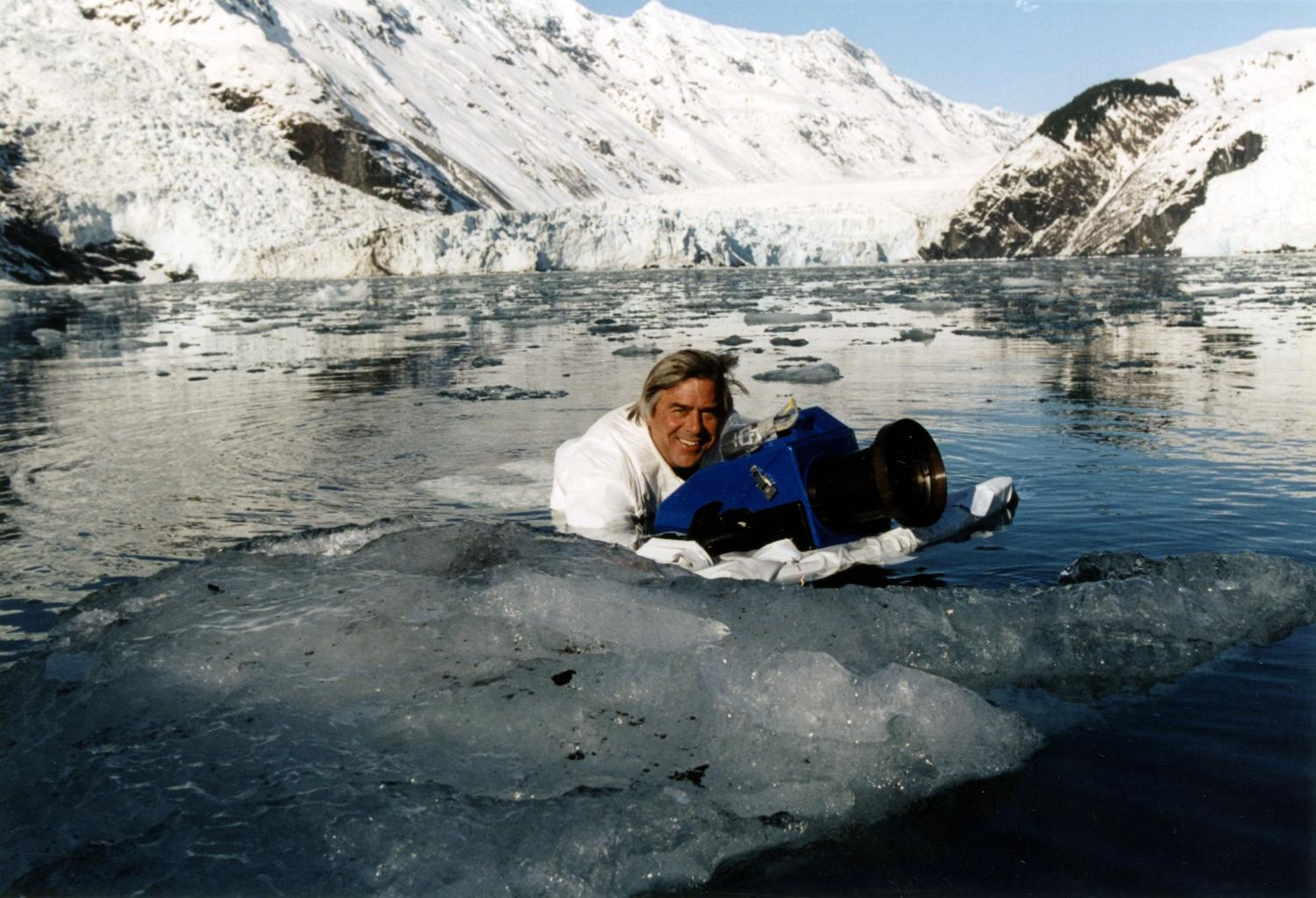 Mike deGruy's white camouflage in icy Alaska helped calm skittish sea otters long enough for a filming session. (Circa: 2005) (Courtesy of Alison Hill)