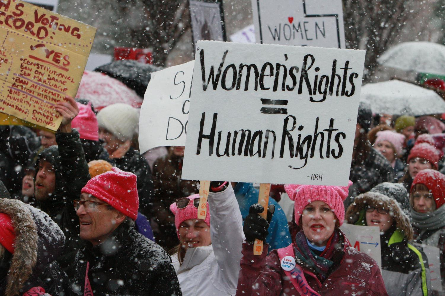 Protesters march up State Street towards the Capitol Building during the Women's March on the Capitol on January 23, 2017. (Photo by Adam Fondren | Daily Utah Chronicle.