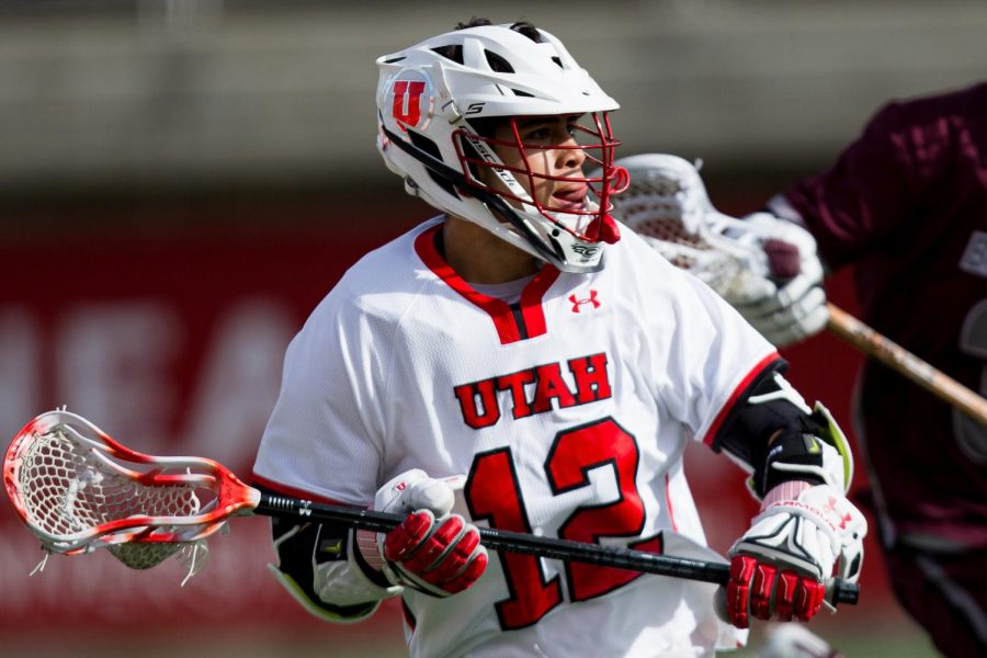 University+of+Utah+Sophomore+Branden+Wilson+%2812%29+looks+to+pass+during+an+NCAA+Lacrosse+game+vs.+Bellarmine+University+at+the+Rice+Eccles+Stadium+in+Salt+Lake+City%2C+Utah+on+Friday%2C+Feb.+01%2C+2020.+%28Photo+by+Abu+Asib+%7C+The+Daily+Utah+Chronicle%29