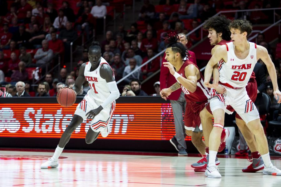 University+of+Utah+sophomore+guard+Both+Gach+%2811%29+dribbles+the+ball+past+Washington+State+players+in+an+NCAA+Men%27s+Basketball+game+vs.+Washington+State+at+Jon+M.+Huntsman+Center+in+Salt+Lake+City%2C+UT+on+Saturday+January+25%2C+2020.%28Photo+by+Curtis+Lin+%7C+Daily+Utah+Chronicle%29