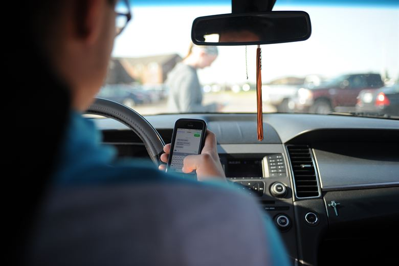 Poma: Banning Handheld Devices While Driving Is Common Sense