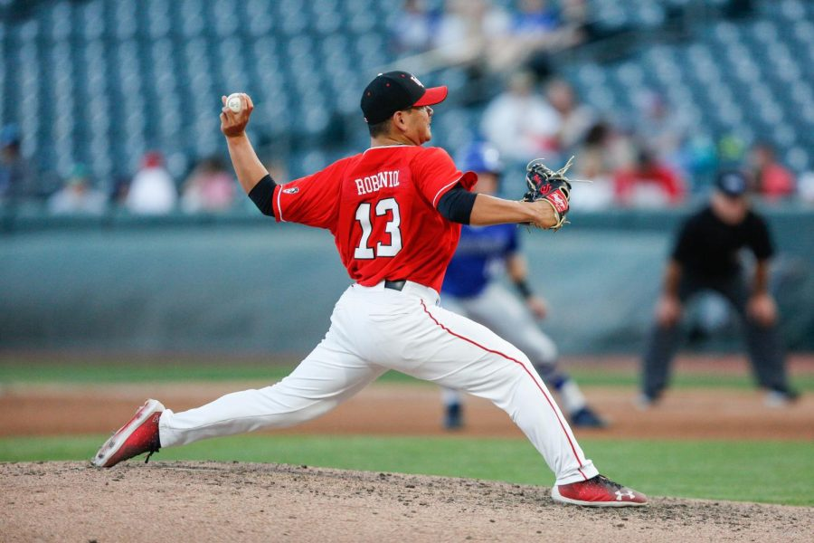 Kyle+Robeniol+%2813%29+throws+a+pitch+as+the+Utes+take+on+the+BYU+Cougars+at+Smith%27s+Ballpark+May+8%2C+2018.+%28Photo+by%3A+Justin+Prather+%7C+Daily+Utah+Chronicle%29