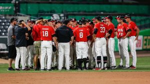 The Utes baseball team celebrates a victory against the BYU Cougars at Smith