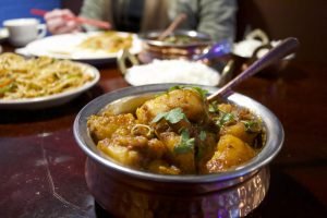 Dinner at House of Tibet featuring Spicy Potatoes (Photo by Kate Button I Daily Utah Chronicle)