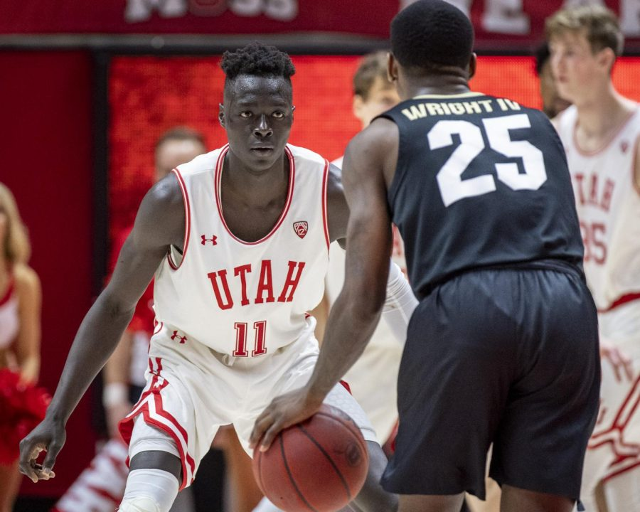 University+of+Utah+sophomore+guard+Both+Gach+%2811%29+guards+University+of+Colorado+junior+guard+McKinley+Wright+IV+%2825%29+during+an+NCAA+Basketball+game+at+the+Jon+M.+Huntsman+Center+in+Salt+Lake+City+on+Saturday%2C+March+7%2C+2020.+%28Photo+by+Kiffer+Creveling+%7C+The+Daily+Utah+Chronicle%29