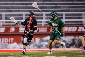 University of Utah junior attacker Jimmy Perkins (4) looked to pass to a teammate in an NCAA Men's Lacrosse game vs. Vermont at Rice-Eccles Stadium in Salt Lake City, UT on Friday February 01, 2019.(Photo by Curtis Lin | Daily Utah Chronicle)