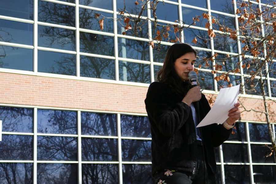 Audrey Stegman, elections registrar, reads the election results in front of the A. Ray Olin Union on Feb. 28, 2020. (Photo by Ivana Martinez   Daily Utah Chronicle)