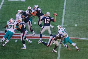 Tom Brady and other New England Patriots players face the Miami Dolphins at Gillette Stadium in Nov. 2009. (Courtesy Wikimedia Commons)