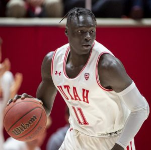 University of Utah sophomore guard Both Gach (11) dribbles the ball during an NCAA Basketball game vs. The University of Washington at the Jon M. Huntsman Center in Salt Lake City, Utah on Thursday, Jan. 23, 2020. (Photo by Kiffer Creveling | The Daily Utah Chronicle)