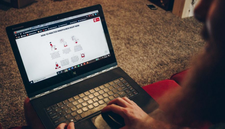 Quinn Case, a University of Utah undergraduate majoring in PRT, reads the 'Practice Mindfulness' page on the University Utah Mindfulness Center website while at his apartment in Salt Lake City on May 19th, 2020. (Photo by Mark Draper | The Daily Utah Chronicle)