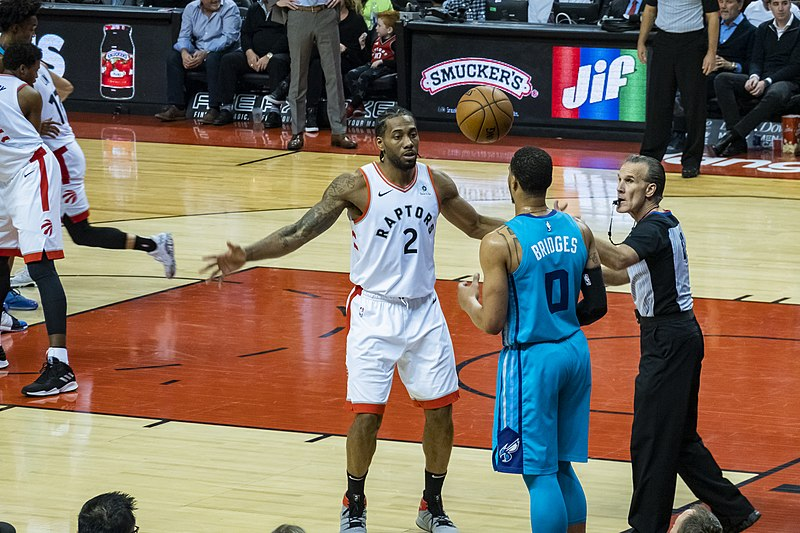 (Kawhi Leonard playing for Toronto Raptors Scotiabank Arena vs Charlotte Hornets NBA. Image via WikiMedia Commons)