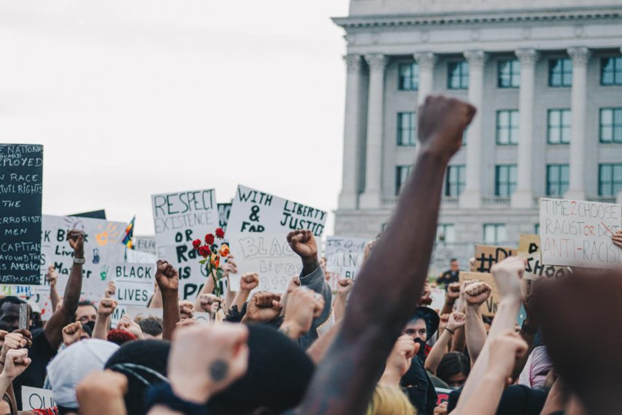 Demonstrators raise their fists in solidarity with the Black Lives Matter movement in front of the Utah State Capitol Building in Salt Lake City, Utah, June 4, 2020. (Photo by Mark Draper | Daily Utah Chronicle)