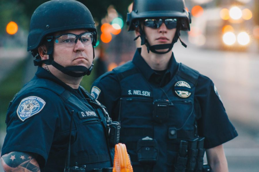 Two Spanish Fork police officers stand watch on 400 S in Salt Lake City, Utah, on June 4, 2020. (Photo by Mark Draper | The Daily Utah Chronicle)