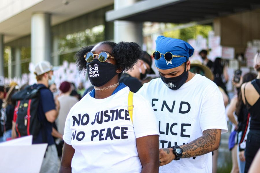 Taylor Natt and her husband Hayden Natt prepare for the protest for Bernardo Palacios in front of the District Attorney's office in Salt Lake City on June 24, 2020. (Photo by Ivana Martinez| Daily Utah Chronicle)