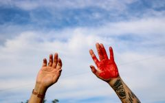 Protesters paint the streets red, to illustrates all the blood that has been spilled by the police at the District Attorney's Office in  Salt Lake City on June 27, 2020. (Photo by Ivana Martinez | Daily Utah Chronicle)
