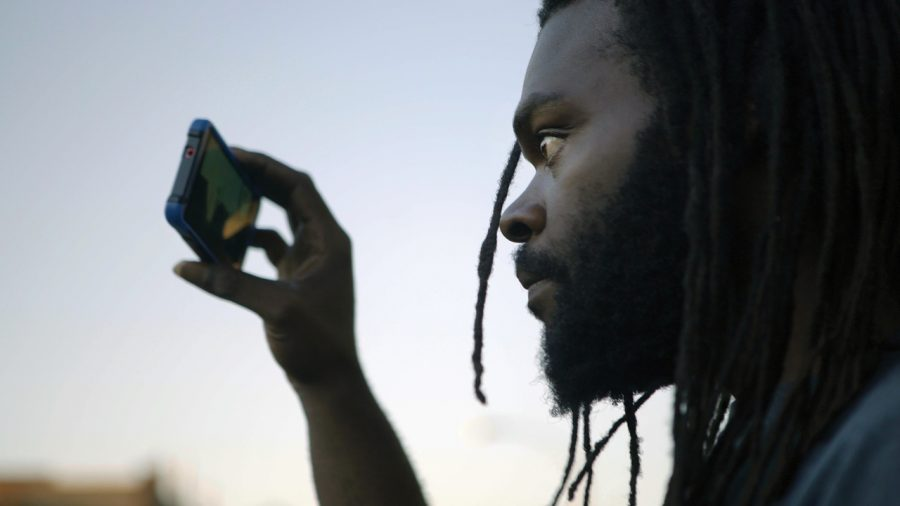 Kevin Moore keeps a trained eye on the police as a cop-watcher to film acts of police brutality (Courtesy Tribeca Film Festival)