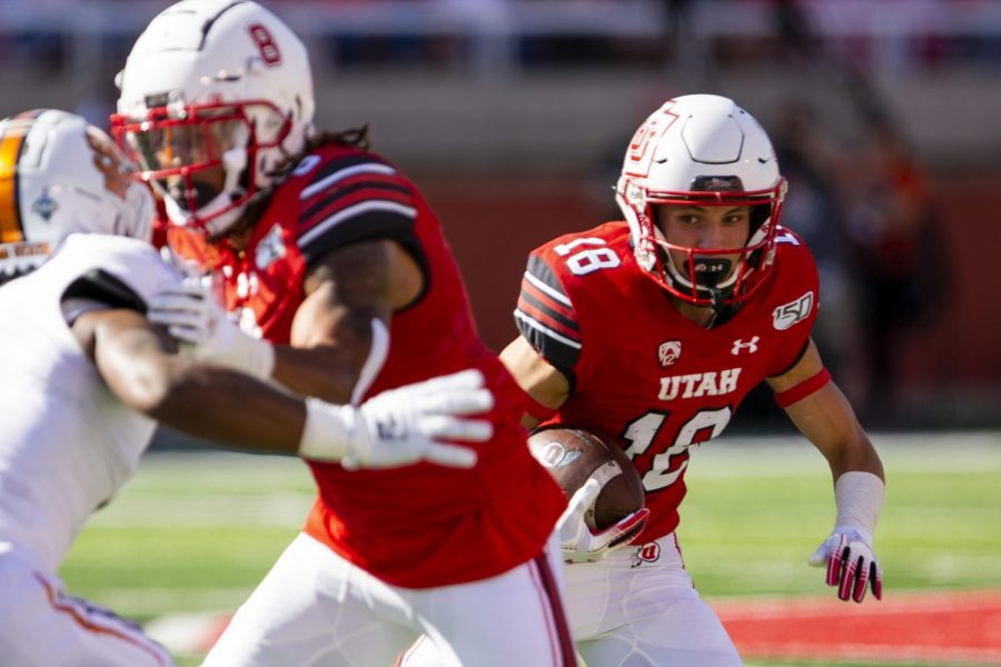 University+of+Utah+junior+wide+receiver+Britain+Covey+%2818%29+running+with+the+ball+after+catching+a+pass+from+University+of+Utah+senior+quarterback+Tyler+Huntley+%281%29+in+an+NCAA+Football+game+vs.+Idaho+State+University+at+Rice-Eccles+Stadium+in+Salt+Lake+City%2C+UT+on+Saturday+September+14%2C+2019.%28Photo+by+Curtis+Lin+%7C+Daily+Utah+Chronicle%29