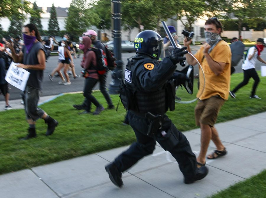 Salt Lake police officers in riot gear charge at protesters in the streets of Salt Lake City on July 9, 2020. (Photo by Ivana Martinez | Daily Utah Chronicle)