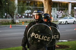 Police in riot gear surround and block in protesters in the streets of Salt Lake City on July 9, 2020. (Photo by Ivana Martinez | Daily Utah Chronicle)