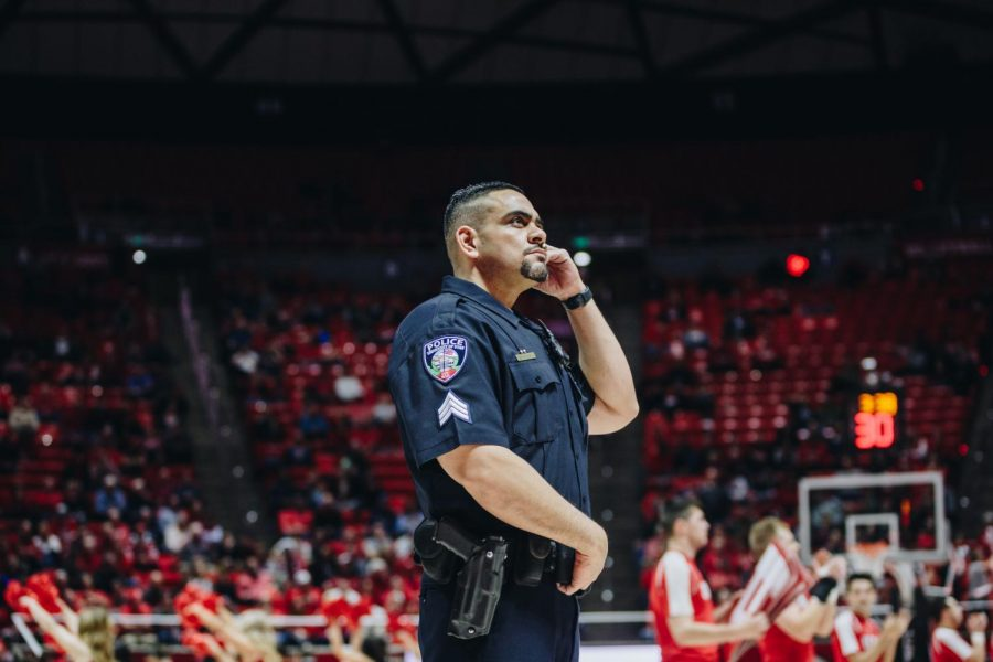University of Utah police officer M. Veatupu surveys the crowd during a time out in the UCLA vs. Utah basketball game at the Huntsman Center, University of Utah Campus, Salt Lake City, UT on Thursday, February 20th, 2020. (Photo by Mark Draper | The Daily Utah Chronicle)