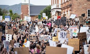 Protesters raise their sign in Salt Lake City, Utah on June 4th 2020.(Photo by Manasij Mukherjee | The Daily Utah Chronicle)