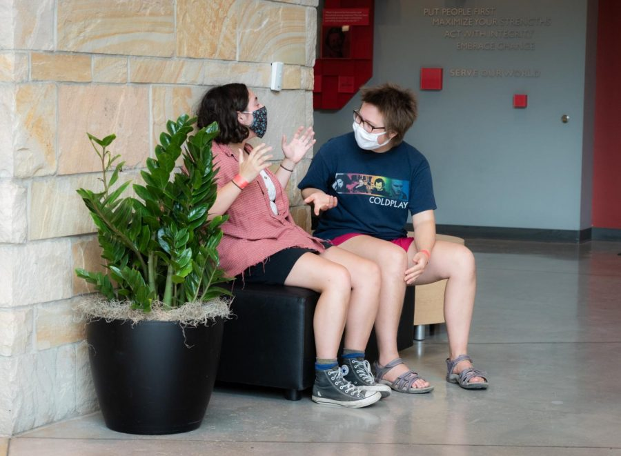 Two students in the MHC lobby wearing masks. (Photo by Jack Gambassi)
