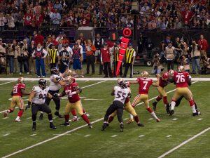 San Francisco 49ers quarterback Colin Kaepernick attempts a pass in Super Bowl XLVII. (Image via WikiMedia Commons)