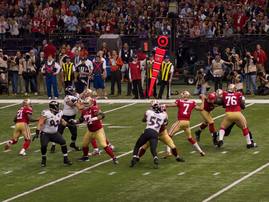 San Francisco 49ers quarterback Colin Kaepernick attempts a pass in Super Bowl XLVII. (Image via WikiMedia Commons)