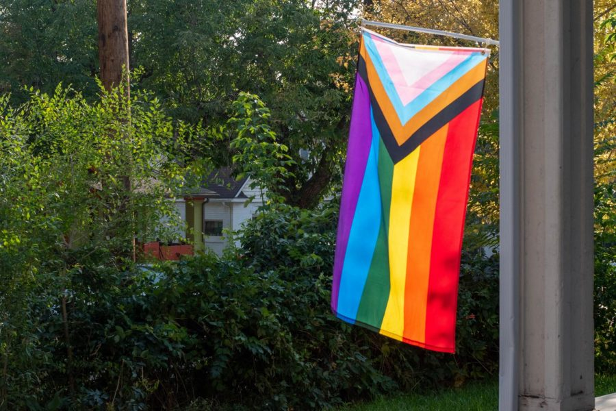 A pride flag hangs from a house in Salt Lake City, Utah on September 21st 2020. This design of the pride flag includes Black, Brown and trans pride. (Photo by Gwen Christopherson | The Daily Utah Chronicle)