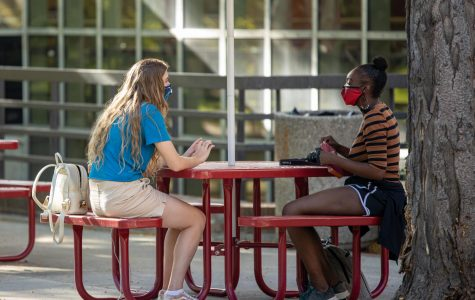 Students at the University of Utah are following the COVID-19 guidelines by wearing masks while working on campus (Photo by Abu Asib | The Daily Utah Chronicle)