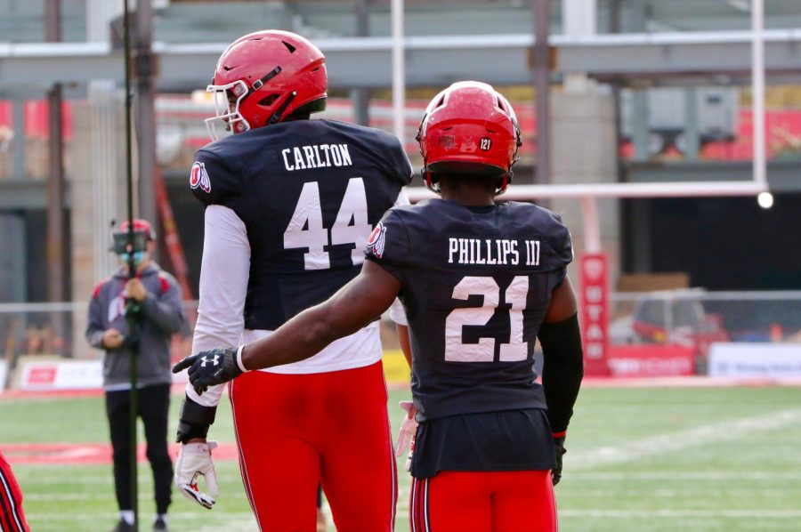 True freshmen Xavier Carlton (44) and Clark Phillips III (21) at Utah Football practice. (Image Courtesy: Utah Athletics)