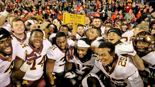 Minnesota players celebrate with the Paul Bunyan Axe trophy after beating Wisconsin 37-15 in an NCAA college football game Saturday, Nov. 24, 2018, in Madison, Wis. (AP Photo/Andy Manis) Photo via WikiMedia Commons