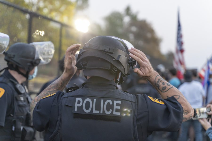 Police Officers assemble outside of The University of Utah in Salt Lake on October 7th, 2020. (Photo by Jake Stranzl | The Daily Utah Chronicle)