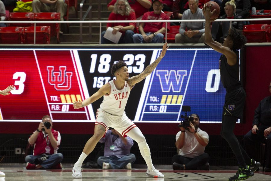 University of Utah sophomore forward Timmy Allen (1) guards University of Washington freshman forward Jaden McDaniels (0) during an NCAA Basketball game at the Jon M. Huntsman Center in Salt Lake City, Utah on Thursday, Jan. 23, 2020. (Photo by Jalen Pace | The Daily Utah Chronicle)