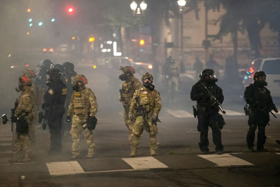 Federal military police occupying Portland, Oregon in July 2020. (Courtesy Nathan Howard, Getty Images)