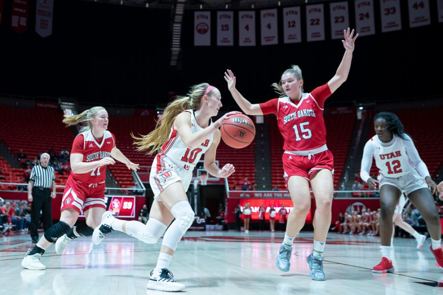 University of Utah Utes Women's Basketball Team Guard Dru Gylten (10) dribbles with the ball during an NCAA Basketball match vs. the South Dakota Coyotes at the Jon M. Huntsman Center in Salt Lake City, Utah on Saturday, Nov. 16, 2019. (Photo by Abu Asib | The Daily Utah Chronicle)