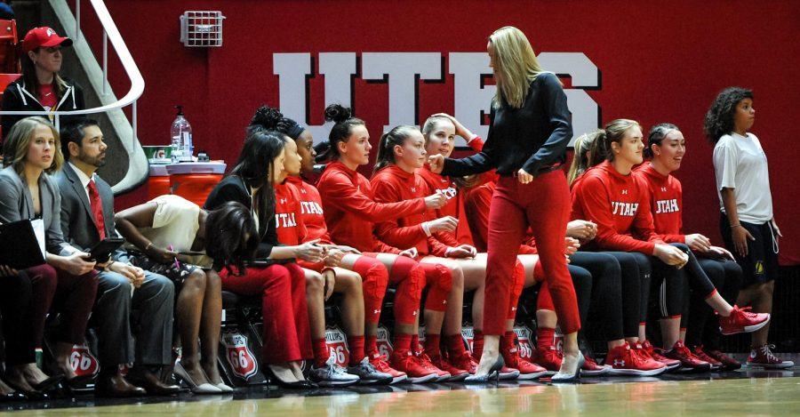 Head Coach Lynne Roberts fist bumps her bench before the game between the Lady Utes and the Colorado Buffalos at the Huntsman Center in Salt Lake, UT on Thursday, Feb. 1, 2018(Photo by Adam Fondren | Daily Utah Chronicle)