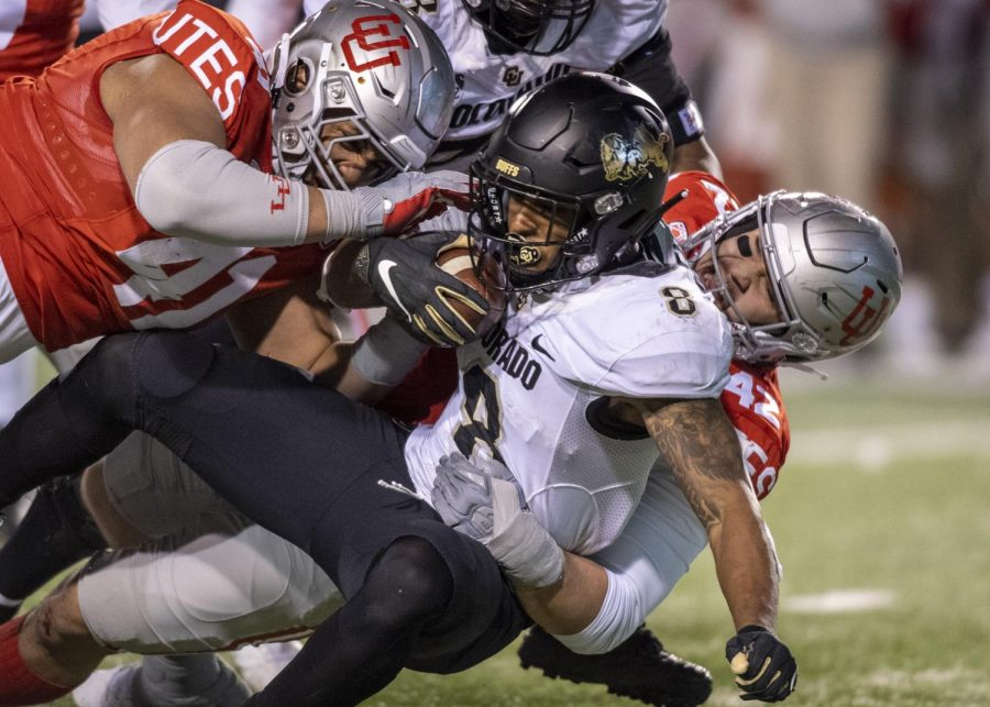 University of Utah sophomore defensive end Mika Tafua (42) and Hauati Pututau (41) tackle University of Colorado sophomore tailback Alex Fontenot (8) during an NCAA Football game at Rice Eccles Stadium in Salt Lake City, Utah on Saturday, Nov. 30, 2019. (Photo by Kiffer Creveling | The Daily Utah Chronicle)