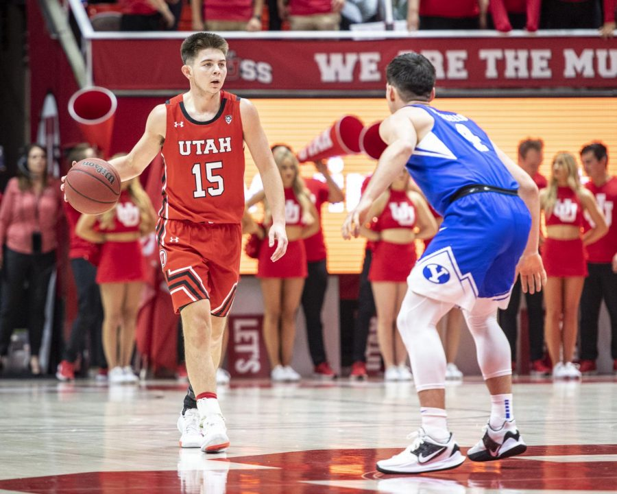University of Utah freshman guard Rylan Jones (15) dribbles the ball near Brigham Young University junior Guard Alex Barcello (4) during an NCAA Basketball game at the Jon M. Huntsman Center in Salt Lake City, Utah on Wednesday, Dec. 4, 2019. (Photo by Kiffer Creveling | The Daily Utah Chronicle)