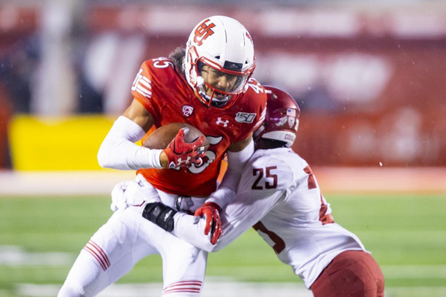 University of Utah junior wide receiver Samson Nacua (45) running with the ball after catching a pass from University of Utah senior quarterback Tyler Huntley (1) in an NCAA Football game vs. Washington State University at Rice-Eccles Stadium in Salt Lake City, UT on Saturday September 28, 2019.(Photo by Curtis Lin | Daily Utah Chronicle)