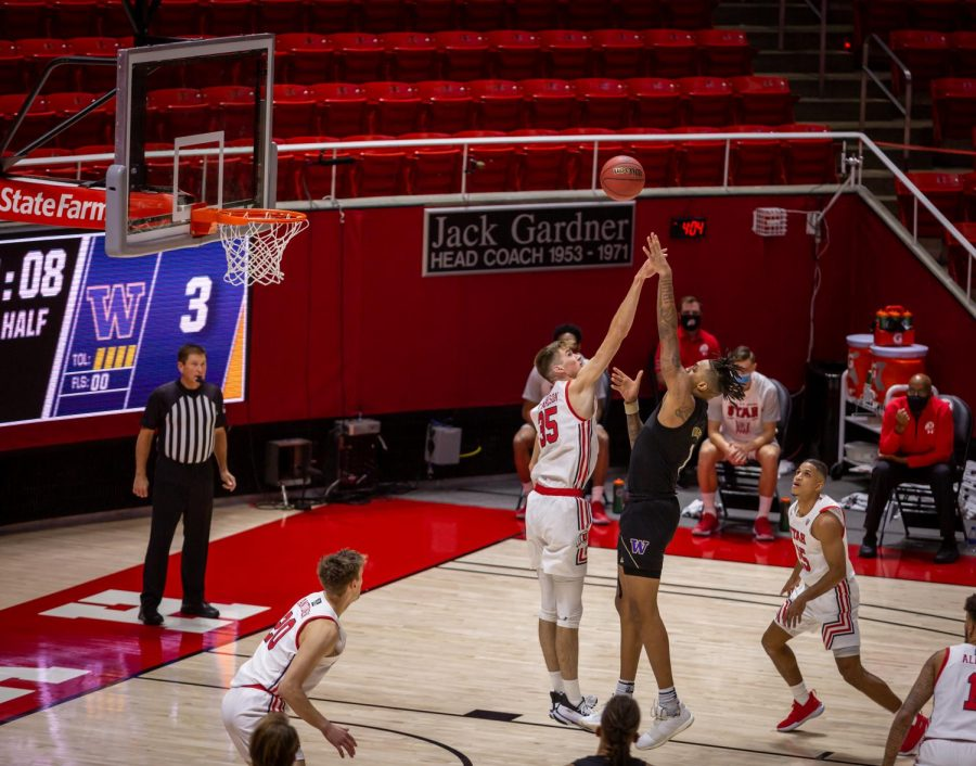 University of Utah Men's Basketball center Branden Carlson (#35) defends University of Washington player Nate Roberts (#1) in the opening game between the two teams in the Jon M. Huntsman Center on U of U campus on Dec. 3, 2020. (Photo by Jack Gambassi | The Daily Utah Chronicle)