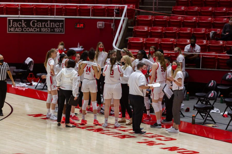 The University of Utah womens basketball team in a timeout huddle during their win against Montana State University on Dec. 11, 2020 in the Jon M. Huntsman Center in Salt Lake City. (Photo by Jack Gambassi | The Daily Utah Chronicle)