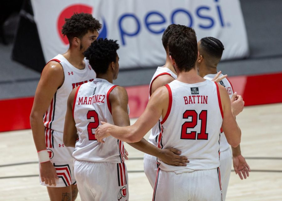 University of Utah men's basketball players in the Utes' win against Utah Valley on Dec. 15, 2020 in the Jon M. Huntsman Center in Salt Lake City. (Photo by Jack Gambassi | The Daily Utah Chronicle)
