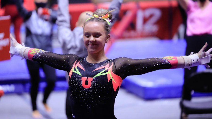 The Utah Red Rocks gymnast and University of Utah sophomore Maile O' Keefe celebrates her performance on the bar against the Arizona Wildcats in an NCAA dual meet at Jon M. Huntsman Center in Salt Lake City on 23 Jan 2021. (Photo by Abu Asib | The Daily Utah Chronicle)