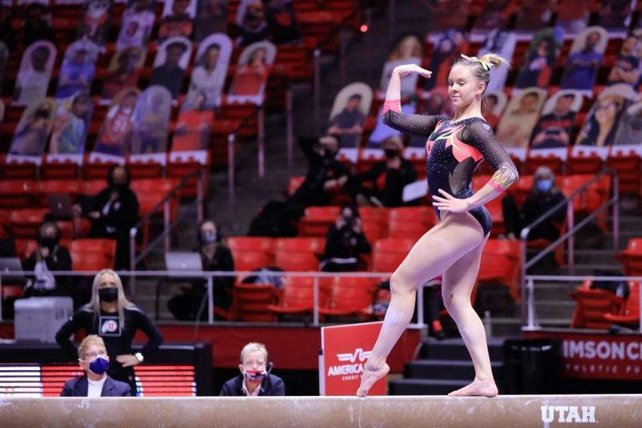 The Utah Red Rocks gymnast and University of Utah sophomore Maile O' Keefe performs on the beam against the Arizona Wildcats in an NCAA dual meet at Jon M. Huntsman Center in Salt Lake City on 23 Jan 2021. (Photo by Abu Asib | The Daily Utah Chronicle)