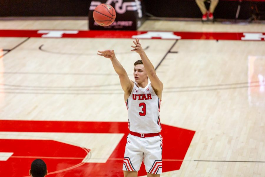 University of Utah Men's Basketball player, Pelle Larsson (#3), takes a 3pt shot in the season-opening game against the University of Washington in the Jon M. Huntsman Center on Dec. 3, 2020. (Photo by Jack Gambassi | The Daily Utah Chronicle)