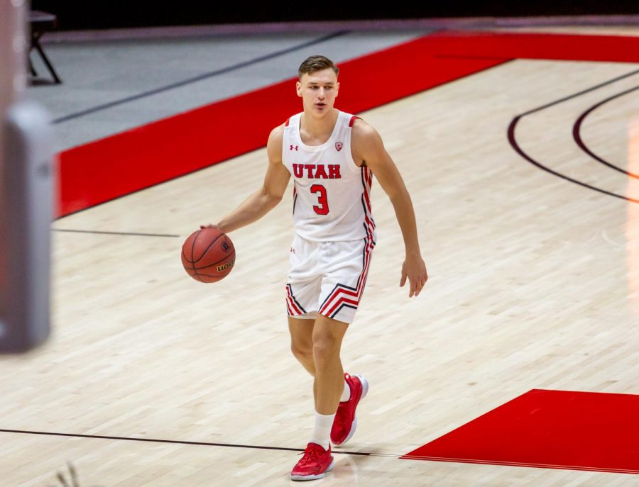 University of Utah Men's Basketball player, Pelle Larsson (#3), brings the ball down the court in the season-opening game against the University of Washington in the Jon M. Huntsman Center on Dec. 3, 2020. (Photo by Jack Gambassi | The Daily Utah Chronicle)