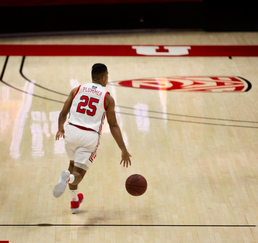 University of Utah men's basketball player, Alfonso Plummer (#3), advances the ball down the court in the game against the Idaho State Bengals on Dec. 8, 2020 in the Jon M. Huntsman Center in Salt Lake City. (Photo by Jack Gambassi | The Daily Utah Chronicle)