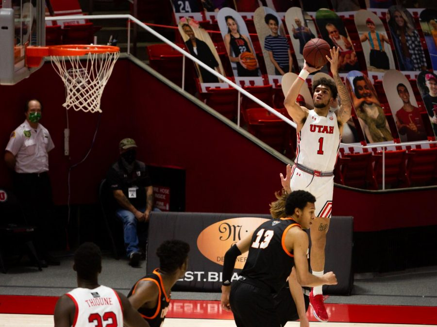 University of Utah men's basketball player, Timmy Allen (#1), attempts a 3pt shot in the game against the Idaho State Bengals on Dec. 8, 2020 in the Jon M. Huntsman Center in Salt Lake City. (Photo by Jack Gambassi | The Daily Utah Chronicle)